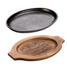 Lodge Cast Iron 10 x 7.5 Inch Oval 2 Piece Serving Griddle with Walnut Stain Wooden Underliner Set